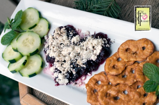 Fat-Free Cranberry Feta Caviar served with cucumber slices and pretzel chips