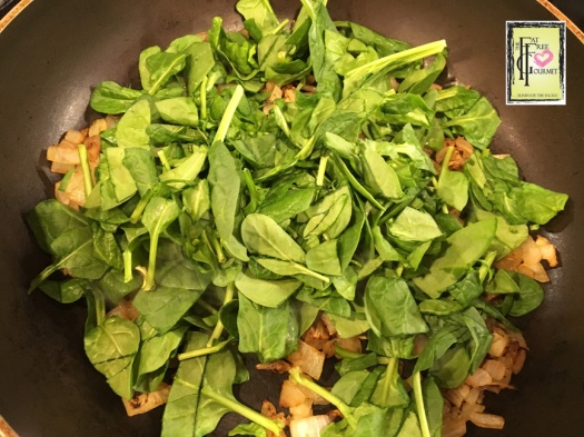 Add baby spinach and a bit of water to wilt and moisten the mixture